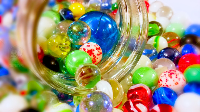 stock-photo-colorful-game-jar-bright-and-bold-jar-of-marbles-65a7fa5b-3cfa-40d0-8ed9-ca2d343cad84